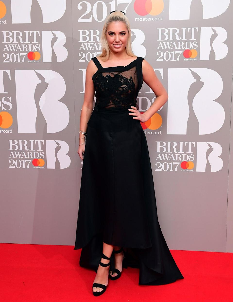 <p>Amber was immensely glamorous in an asymmetric black gown. <i>[Photo: PA]</i> </p>