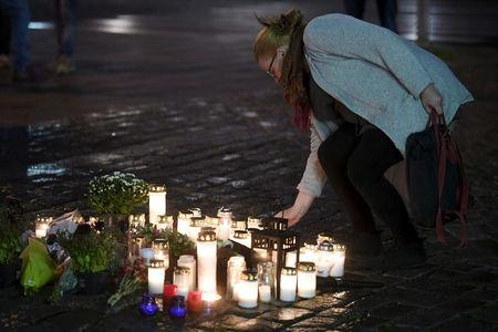 Candles at Turku Market Square for the victims of Friday's stabbings are pictured in Turku