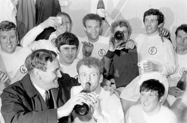 The Leeds players celebrate their 1969 League Championship success with champagne and cigars in the dressing room after a 0-0 draw at Liverpool (back row, left to right) Mick Jones, Jack Charlton, Paul Reaney, Gary Sprake, Johnny Giles, Paul Madeley; (front row) manager Don Revie, Peter Lorimer, Billy Bremner, Eddie Gray