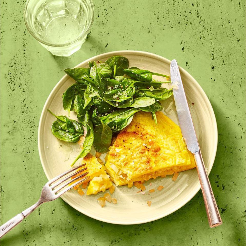 "<p>Simple yet delicious, this omelet, full of tender sauteed onions and salty Parmesan cheese, is elegant enough for dinner. Serve with a side of lemony greens to make the meal complete!</p><p><em><a href=""https://www.goodhousekeeping.com/food-recipes/a35036897/classic-omelet-and-greens-recipe/"" rel=""nofollow noopener"" target=""_blank"" data-ylk=""slk:Get the recipe for Classic Omelet and Greens »"" class=""link rapid-noclick-resp"">Get the recipe for Classic Omelet and Greens »</a></em></p>"