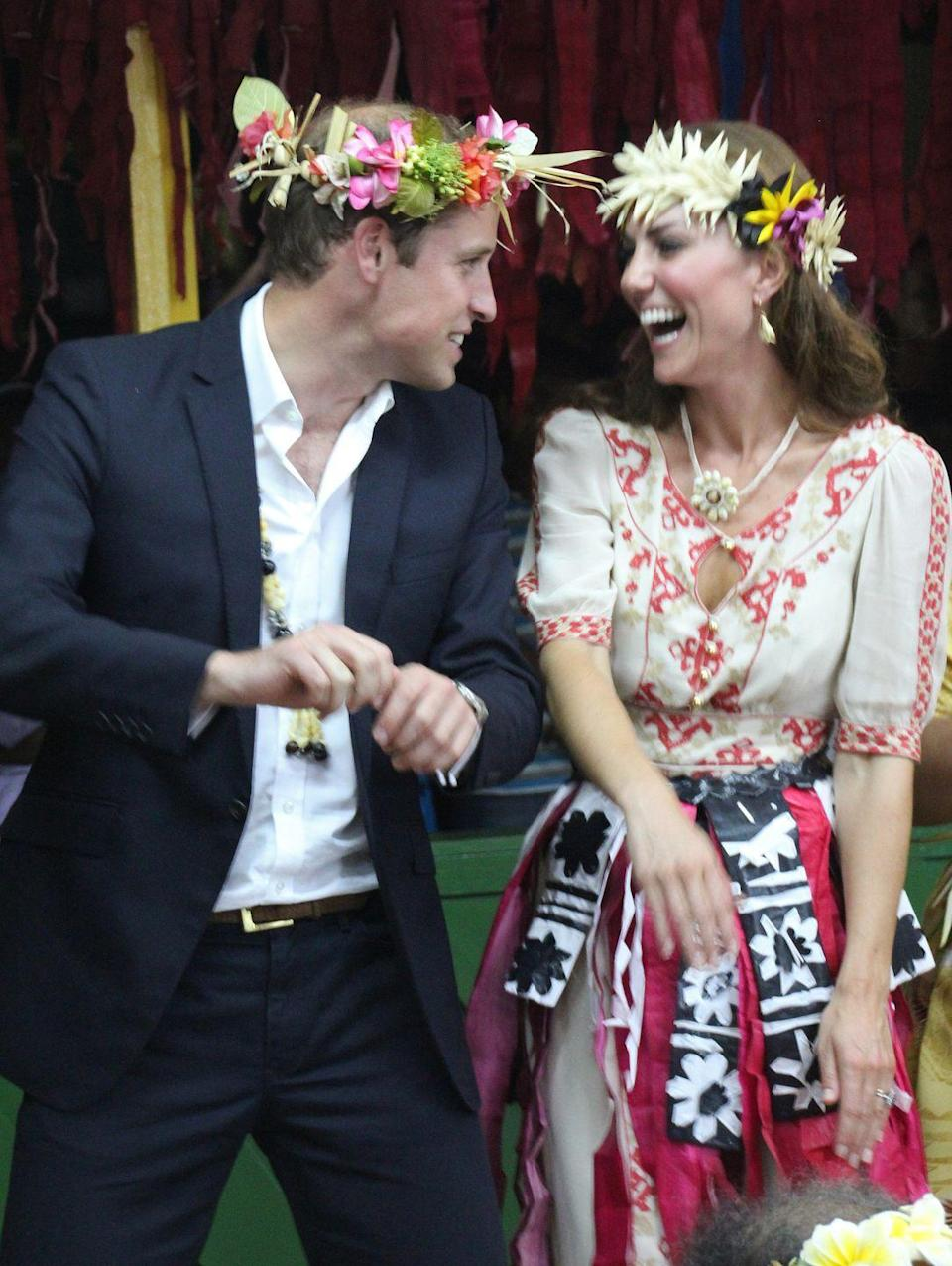 <p>The couple that laughs together stays together and the Duke and Duchess certainly seem to enjoy being around one another! Here they're seen giggling together as they dance in Tuvalu in the South Pacific. Is Prince William practicing his dad dancing?</p>