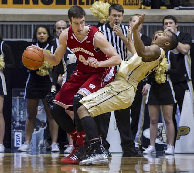 Purdue's Basil Smotherman (5) reacts after making contact with Wisconsin's Frank Kaminsky (44) in the second half of an NCAA college basketball game, Saturday, Jan. 25, 2014, in West Lafayette, Ind. Wisconsin defeated Purdue 72-58. (AP Photo/Doug McSchooler)