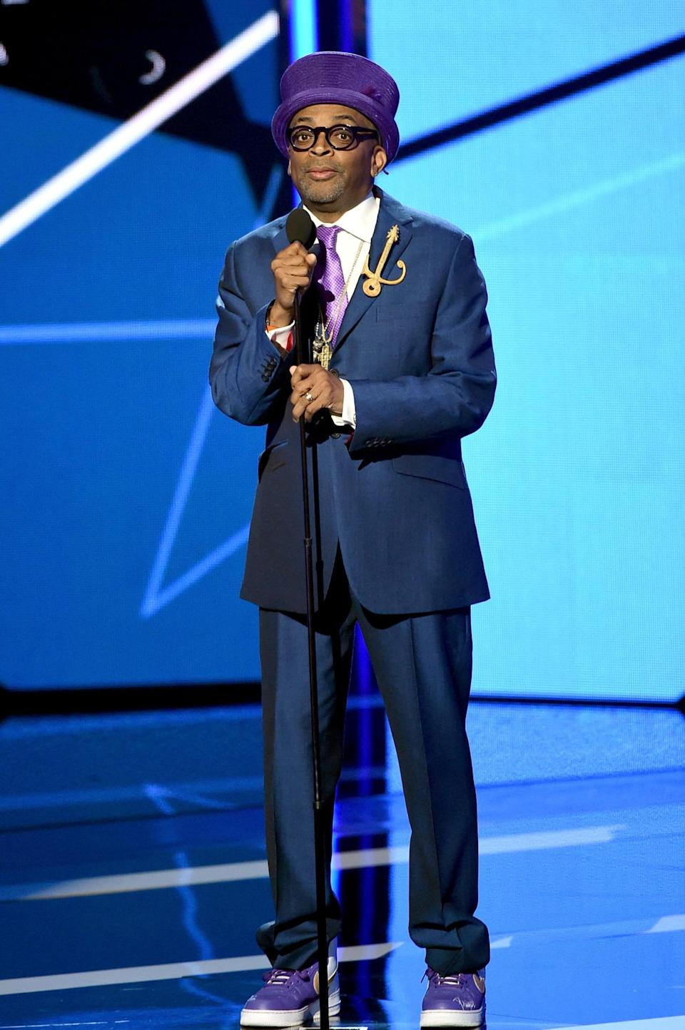 <p>Spike Lee, who gave Samuel L. Jackson his Lifetime Achievement Award, dressed to honor Prince in purple and yellow sneakers, purple tie, Prince symbol pin, and a top hat. Many compared the director's honorific look to Willy Wonka. <i>(Photo: Getty Images)</i></p>