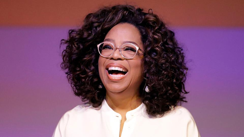 Oprah Winfrey laughing during a tribute to Nelson Mandela and promoting gender equality event at University of Johannesburg in Soweto, South Africa.