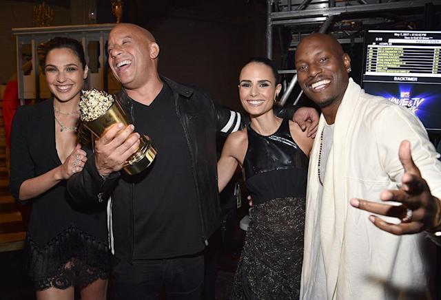 <p>Golden popcorn, anyone? Gal Gadot, Vin Diesel, Jordana Brewster, and Tyrese Gibson won a tub of it — though it probably wouldn't be very tasty — when they took home the MTV Generation Award for the <em>Fast and the Furious </em>franchise at the 2017 MTV Movie And TV Awards. (Photo: Kevin Mazur/WireImage) </p>