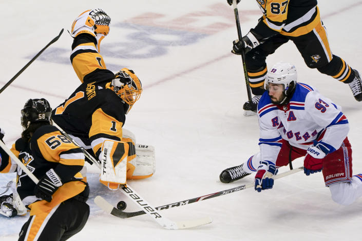 Pittsburgh Penguins goaltender Casey DeSmith (1) stops a shot by New York Rangers' Mika Zibanejad (93) during the first period of an NHL hockey game, Sunday, March 7, 2021, in Pittsburgh. (AP Photo/Keith Srakocic)