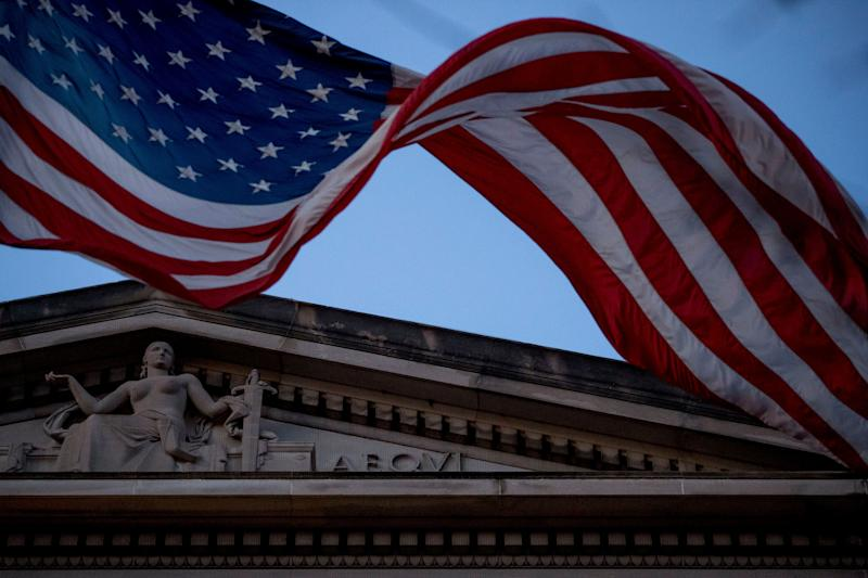 An American flag flies outside the Department of Justice in Washington on March 22, 2019.