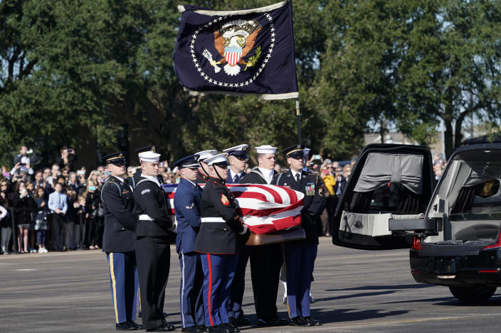 The flag-draped casket of former President George H.W. Bush is carried by a joint services military honor guard to Special Air Mission 41 at Ellington Field during a departure ceremony Monday, Dec. 3, 2018, in Houston. (Photo: David J. Phillip, Pool/AP)