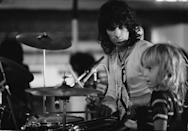 <p>Marlon Richards watches as his dad Keith plays drums during a Rolling Stones soundcheck in London in 1973. </p>
