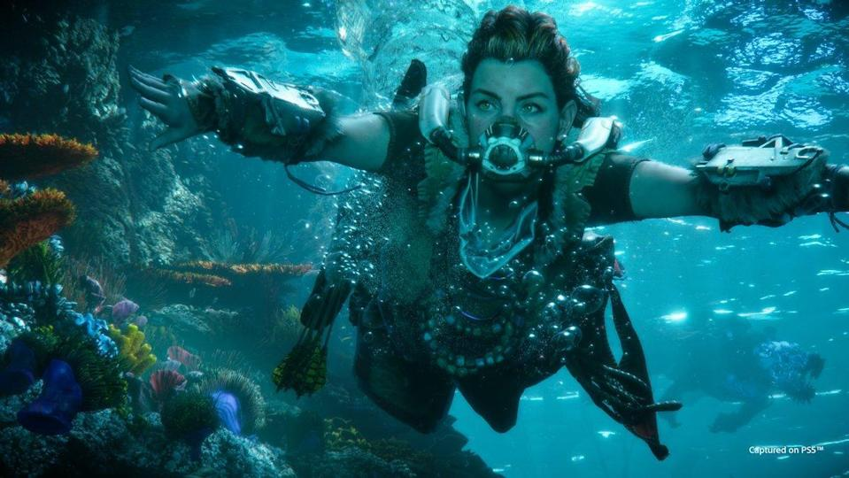 A female video game character swims underwater with scuba gear