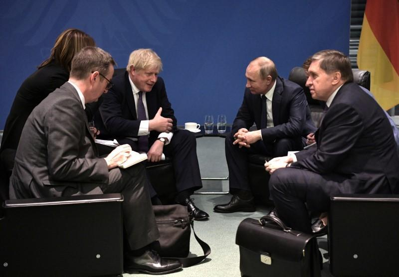 Russia's President Vladimir Putin and Britain's Prime Minister Boris Johnson meet on sideline of the Libya summit in Berlin