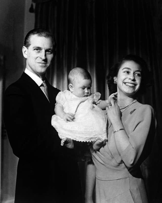Charles is pictured aged six months with the Queen and Duke of Edinburgh (PA Wire)