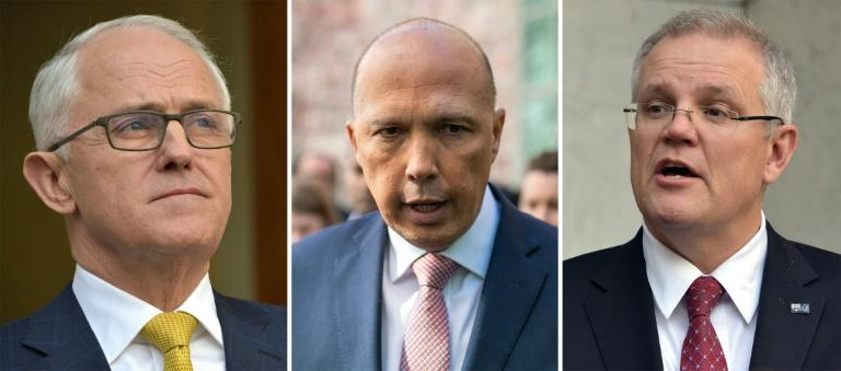 Prime Minister Malcolm Turnbull (L) is facing a fresh challenge from his home affairs minister Peter Dutton (C) but Treasurer Scott Morrison (R) may contest the leadership in a bid to derail Dutton's ambitions