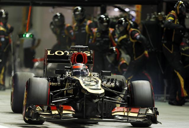 Lotus driver Kimi Raikkonen of Finland drives out of the pit during the Singapore Formula One Grand Prix on the Marina Bay City Circuit in Singapore, Sunday, Sept. 22, 2013.(AP Photo/Pablo Sanchez, POOL)