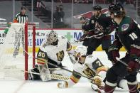 Arizona Coyotes center Christian Dvorak (18) scores a goal against Vegas Golden Knights goaltender Robin Lehner (90) as Golden Knights defenseman Alex Pietrangelo (7), Coyotes center Nick Schmaltz, second from right, and Coyotes right wing Conor Garland look on during the first period of an NHL hockey game Friday, Jan. 22, 2021, in Glendale, Ariz. (AP Photo/Ross D. Franklin)