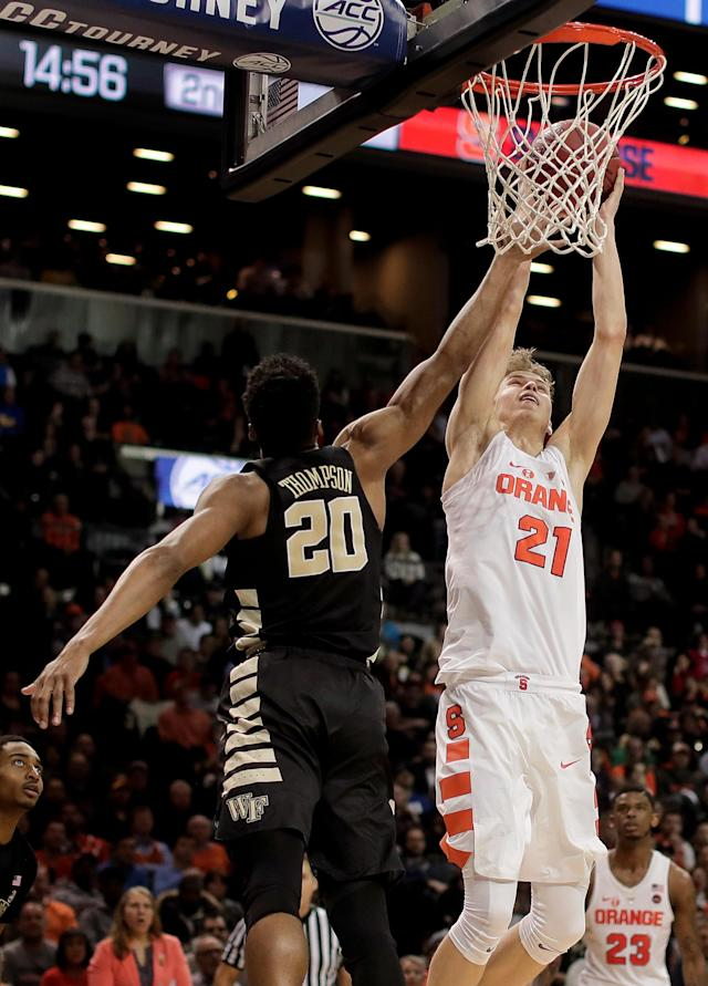 Syracuse forward Marek Dolezaj (21) shoots against Wake Forest forward Terrence Thompson (20) during the second half of an NCAA college basketball game in the Atlantic Coast Conference men's tournament Tuesday, March 6, 2018, in New York. Syracuse won 73-64. (AP Photo/Julie Jacobson)