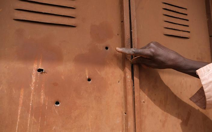 Bullet holes at the school from which the boys were taken - GETTY IMAGES