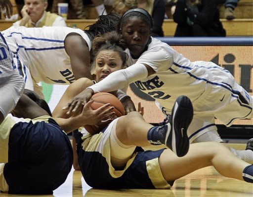 Duke's Alexis Jones (2) and Elizabeth Williams, rear, struggle for possession with Georgia Tech's Danielle Hamilton-Carter during the first half of an NCAA women's college basketball game in Durham, N.C., Thursday, Dec. 6, 2012. (AP Photo/Gerry Broome)