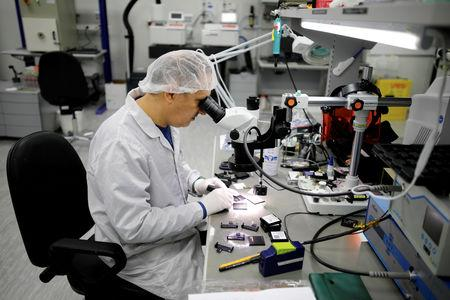FILE PHOTO: A technician works in a cleanroom at Mellanox Technologies building in Yokneam, Israel March 4, 2019. Picture taken March 4, 2019. REUTERS/Amir Cohen/File Photo