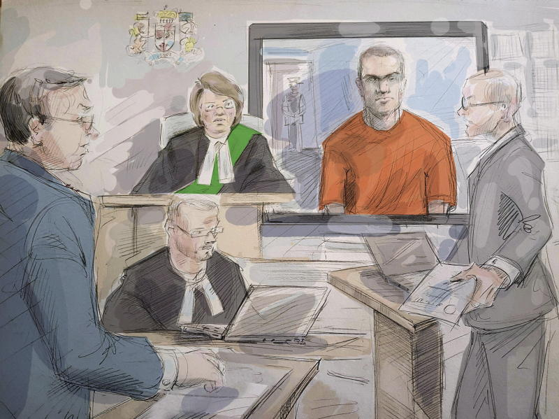 File-This photo taken May 10, 2018, shows defense lawyer Boris Bytensky, left to right, Justice Ruby Wong, Alek Minassian and Crown prosecutor Joe Callaghan  in court as Minassian appears by video in Toronto. A newly released video shows Minassian, accused of driving a van into pedestrians in Toronto and killing 10 people, telling police he accomplished his mission and that he's part of an online group of sexually frustrated men who plot attacks against people who have sex.  (Alexandra Newbould/The Canadian Press via AP, File)