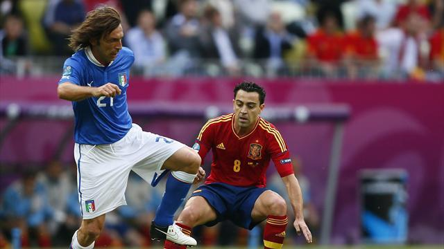 Italy's Andrea Pirlo (L) and Spain's Xavi Hernandez (R) challenge for the ball during their Group C Euro 2012 match at the PGE Arena in Gdansk. (Reuters)