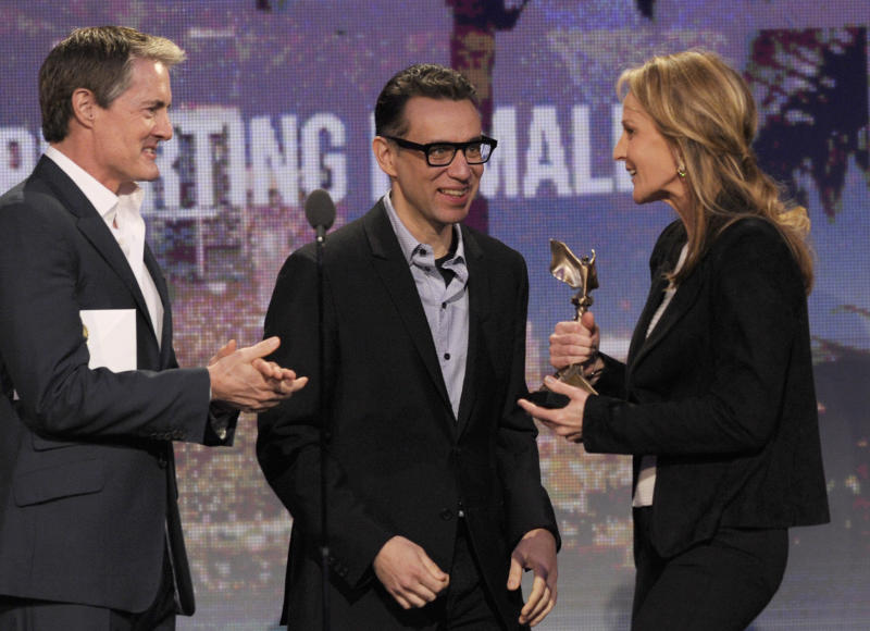 """Actors Kyle MacLachlan, left, and Fred Armisen, center, present Helen Hunt with the award for best supporting female for """"The Sessions"""" at the Independent Spirit Awards on Saturday, Feb. 23, 2013, in Santa Monica, Calif. (Photo by Chris Pizzello/Invision/AP)"""
