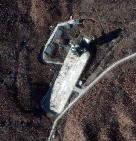 FILE - This Nov. 23, 2012 satellite file image provided by DigitalGlobe shows the Sohae Satellite Launch Station in Cholsan County, North Pyongan Province, North Korea. Rocket sections are apparently being trucked into North Korea's northwest launch site, but some analysts are asking whether it's just a calculated bluff meant to jangle the Obama administration and influence South Korean voters ahead of presidential elections in three weeks. (AP Photo/DigitalGlobe, File)