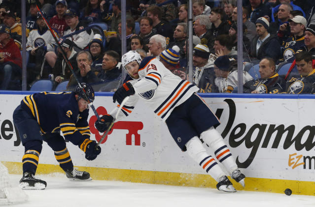 Buffalo Sabres forward Jack Eichel (9) and Edmonton Oilers forward Leon Draisaitl (29) collide during the second period of an NHL hockey game, Monday, March 4, 2019, in Buffalo N.Y. (AP Photo/Jeffrey T. Barnes)