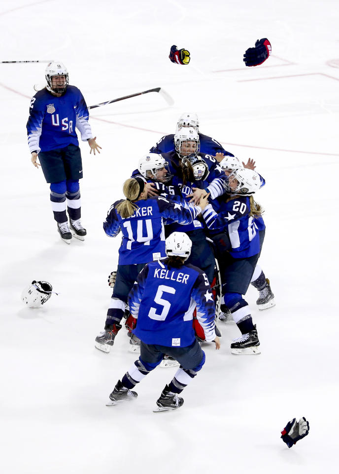 <p>Players of Team USA celebrate winning the gold medal following the Women's Ice Hockey Gold Medal game final between USA and Canada at the PyeongChang 2018 Winter Olympic Games in South Korea, February 22, 2018.<br /> (Photo by Jean Catuffe/Getty Images) </p>
