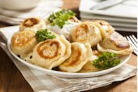 """<p>Polish immigrants brought pierogies to the Midwest, which are so beloved in some cities, you can have pierogies as a side instead of fries at restaurants! Recreate that wonder at home with this easy take on pierogies, which <a href=""""https://www.thedailymeal.com/cook/10-things-you-didn-t-know-you-could-make-bisquick-slideshow?referrer=yahoo&category=beauty_food&include_utm=1&utm_medium=referral&utm_source=yahoo&utm_campaign=feed"""" rel=""""nofollow noopener"""" target=""""_blank"""" data-ylk=""""slk:uses biscuit mix"""" class=""""link rapid-noclick-resp"""">uses biscuit mix</a> in the dough.</p> <p><a href=""""https://www.thedailymeal.com/potato-cheese-pierogi-recipe?referrer=yahoo&category=beauty_food&include_utm=1&utm_medium=referral&utm_source=yahoo&utm_campaign=feed"""" rel=""""nofollow noopener"""" target=""""_blank"""" data-ylk=""""slk:For the Potato Cheese Pierogi recipe, click here."""" class=""""link rapid-noclick-resp"""">For the Potato Cheese Pierogi recipe, click here.</a></p>"""