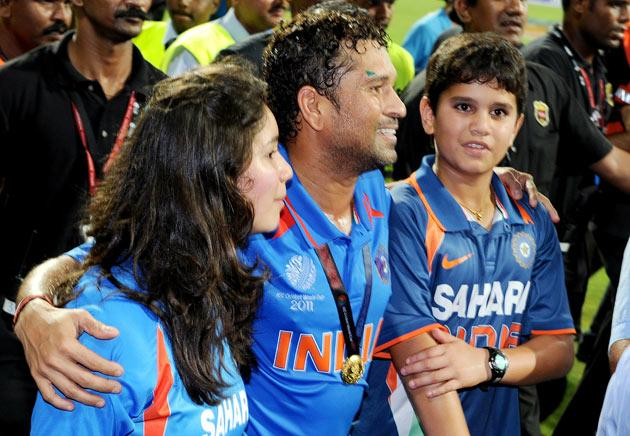 Indian player Sachin Tendulkar (C) walks with his children Ramesh (R) and daughter Sara (L) after India defeated Sri Lanka in the ICC Cricket World Cup 2011 final played at The Wankhede Stadium in Mumbai on April 2, 2011.  India beat Sri Lanka by six wickets.  AFP PHOTO/William WEST
