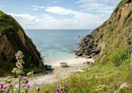 """<p>For many during lockdown, Cornwall's stunning coastline vistas were only viewable while bingeing the popular BBC series, Poldark. With travel restrictions lifted, a trip to experience the show's epic scenery in person tops the list of to-dos. Take a dip in Porthgwarra's cool, crystal clear waters - the same where a certain leading man swam shirtless for the show.<br></p><p><strong>Don't Miss:</strong> Poldark super fans will want to head to <u><a href=""""https://www.staubynestatescottages.co.uk/porthgwarra-cove-cafe?_ga=2.100727105.1551020044.1550745711-791527769.1529333450&fbclid=IwAR2LSmDORO-ylHWrDbLb4YtNJkRp7WlKDLYXJQb1e3SjsjAVLCMydA2DHOo"""" rel=""""nofollow noopener"""" target=""""_blank"""" data-ylk=""""slk:Porthgwarra Cove Cafe"""" class=""""link rapid-noclick-resp"""">Porthgwarra Cove Cafe</a></u>, a spot favoured by the show's cast and crew for meals during filming.</p>"""