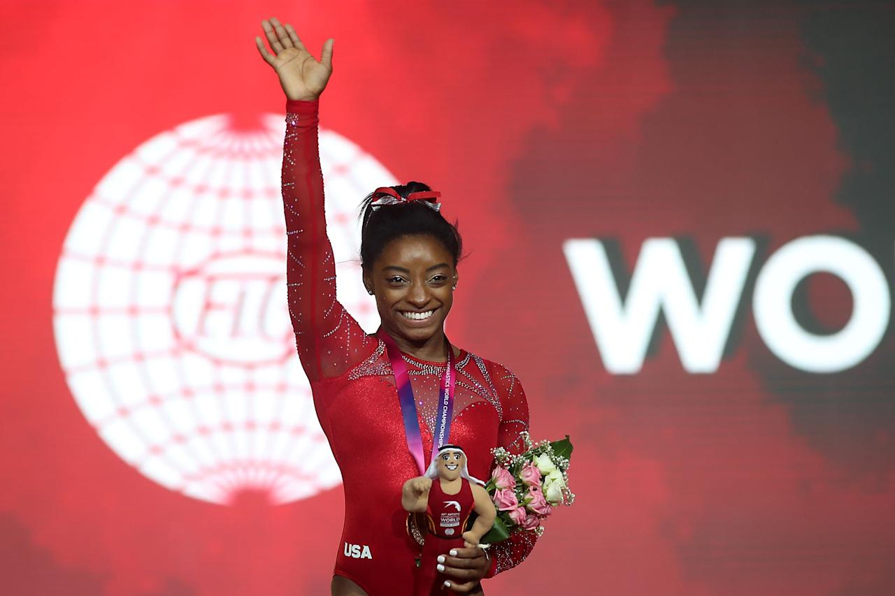 "<p>Despite leading Team USA to gold at the 2018 Gymnastics World Championships in Doha, <a href=""https://www.popsugar.com/fitness/Simone-Biles-World-Championship-After-Kidney-Stone-2018-45428392"" class=""ga-track"" data-ga-category=""Related"" data-ga-label=""http://www.popsugar.com/fitness/Simone-Biles-World-Championship-After-Kidney-Stone-2018-45428392"" data-ga-action=""In-Line Links"">Simone was suffering severe pain from a kidney stone</a>. Though she'd been admitted to the hospital before the meet, she'd left without passing the stone, which <a href=""http://www.usatoday.com/story/sports/columnist/nancy-armour/2018/10/27/simone-biles-joins-mj-and-tiger-woods-iconic-performances/1790405002/"" target=""_blank"" class=""ga-track"" data-ga-category=""Related"" data-ga-label=""http://www.usatoday.com/story/sports/columnist/nancy-armour/2018/10/27/simone-biles-joins-mj-and-tiger-woods-iconic-performances/1790405002/"" data-ga-action=""In-Line Links"">she lovingly nicknamed the ""Doha Pearl""</a> due to its size. She later joked to <strong>USA Today</strong>, ""I'm trying not to move every time I do something just in case [the stone] moves. Then I also hear roller coasters might help kidney stones, and I'm like my own roller coaster out there.""</p>"