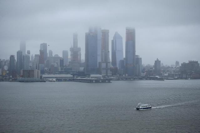 <p>A NY Waterway ferry sails on the Hudson River as the winter storm Quinn approaches New York City on March 7, 2018, in Weehawken, New Jersey. This is the second nor'easter to hit the area within a week and it is expected to bring heavy snowfall and winds, raising fears of another round of electrical outages. (Photo: Kena Betancur/Getty Images) </p>