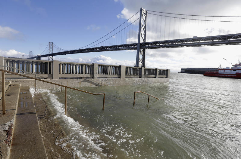 FILE - In this Jan. 11, 2017, file photo, water from a king tide floods a staircase along the Embarcadero in San Francisco. The state's Ocean Protection Council decided Wednesday, April 26 to update its sea-rise guidance for state and local governments. That's mainly because of findings that Antarctic ice sheets are melting increasingly fast. The new projections forecast at least a 1-foot (one-third meter) rise off California by the end of the century. That jumps to 10-feet (3 meters) if the Antarctic ice sheets melt far more rapidly. (AP Photo/Jeff Chiu, File)