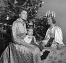 <p>Swedish actress Ingrid Bergman celebrates her culture's traditions with her two-year-old son, Renato Roberto Rossellini. </p>