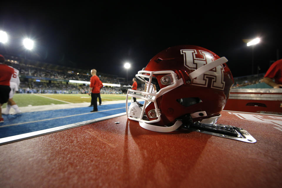 A Houston football helmet sits on the sideline in the first half of an NCAA college football game against Tulane in New Orleans, Thursday, Sept. 19, 2019. (AP Photo/Gerald Herbert)
