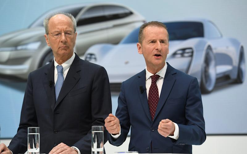 Volkswagen CEO Herbert Diess, right, and chairman Hans Dieter Poetsch address the media at the VW plant in Wolfsburg, Germany, in April. Photo: Fabian Bimmer/Reuters