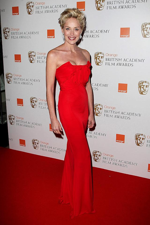 "At 50, Sharon Stone is still a stunner. The actress wore this crimson John Galliano creation to the BAFTA Awards. Dave Hogan/<a href=""http://www.gettyimages.com/"" target=""new"">GettyImages.com</a> - February 8, 2009"