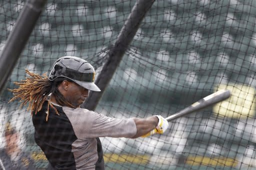 Pittsburgh Pirates' Andrew McCutchen takes batting practice before an exhibition spring training baseball game against the Baltimore Orioles, Sunday, March 24, 2013 in Bradenton, Fla. (AP Photo/Carlos Osorio)
