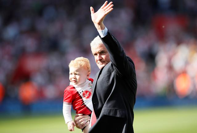 "Soccer Football - Premier League - Southampton vs Manchester City - St Mary's Stadium, Southampton, Britain - May 13, 2018 Southampton manager Mark Hughes with child during a lap of honour after the match REUTERS/David Klein EDITORIAL USE ONLY. No use with unauthorized audio, video, data, fixture lists, club/league logos or ""live"" services. Online in-match use limited to 75 images, no video emulation. No use in betting, games or single club/league/player publications. Please contact your account representative for further details."