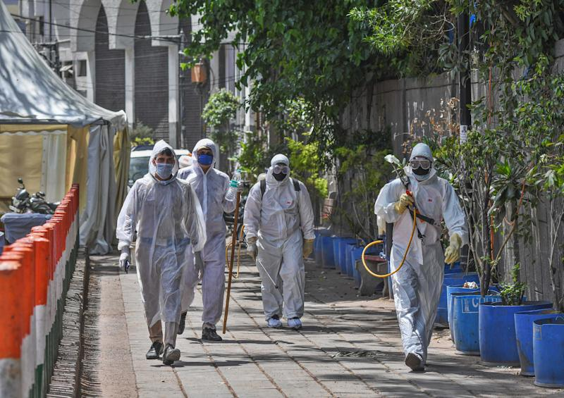 Delhi Government public health employees leave after a sanitization drive at the Alami Markaz Banglewali Masjid area on day eight of the 21 day nationwide lockdown imposed by PM Narendra Modi to curb the spread of coronavirus, at Nizamuddin on April 1, 2020 in New Delhi, India. (Photo by Biplov Bhuyan/Hindustan Times via Getty Images)