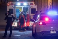 A person is treated by an ambulance crew in an area where multiple people were stabbed in Quebec City