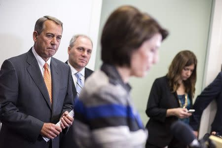 Speaker of the House John Boehner (R-OH) and House Majority Whip Steve Scalise (R-LA) listen to Cathy McMorris Rodgers (R-WA) speak during a press conference calling for for U.S. President Barack Obama not to veto the Keystone XL pipeline on Capitol Hill in Washington November 18, 2014.      REUTERS/Joshua Roberts