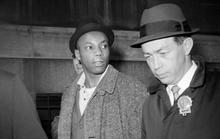 Image: Muhammad Abdul Aziz is escorted by detectives after his arrest in New York on Feb. 26, 1965.