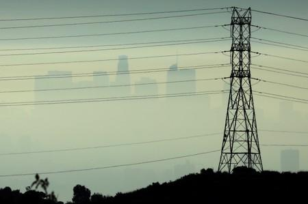 FILE PHOTO: Downtown Los Angeles is seen behind an electricity pylon through the morning marine layer in Los Angeles