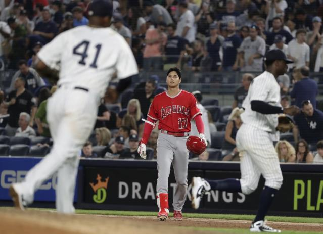 Los Angeles Angels' Shohei Ohtani (17), of Japan, reacts after he was thrown out at first base during the eighth inning of the team's baseball game against the New York Yankees Friday, May 25, 2018, in New York. The Yankees won 2-1. (AP Photo/Frank Franklin II)