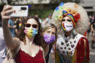 """Revelers take part in the Christopher Street Day (CSD) parade, in Berlin, Saturday, July 24, 2021. The official motto of the CSD is """"Save our Community - save our Pride"""". (J'rg Carstensen/dpa via AP)"""