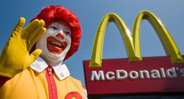 Ronald McDonald waves to kids outside a newly opened McDonald's franchise in West Haven, CT, USA