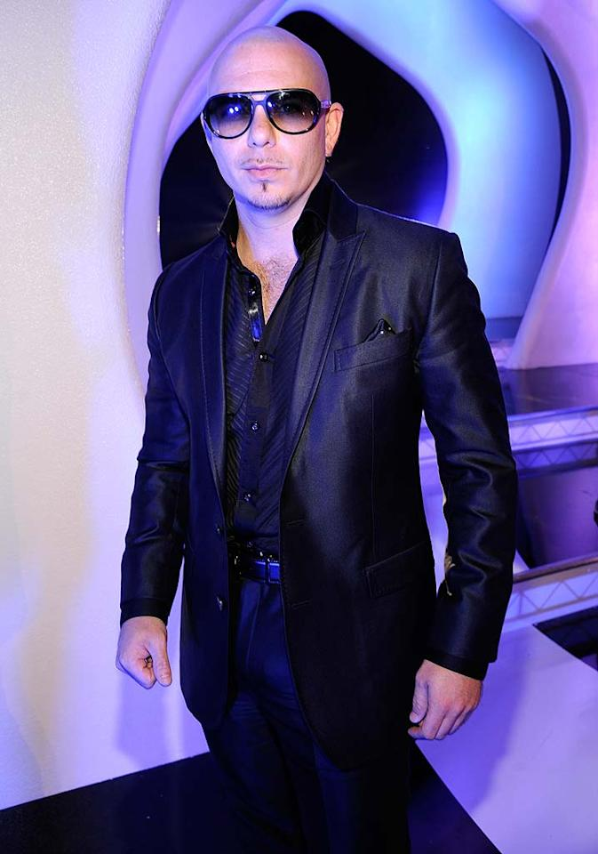 """Pitbull -- who ruled the airwaves this summer with his smash hit """"Give Me Everything"""" -- rocked an all-black getup and matching shades. Kevin Mazur/<a href=""""http://www.wireimage.com"""" target=""""new"""">WireImage.com</a> - August 28, 2011"""